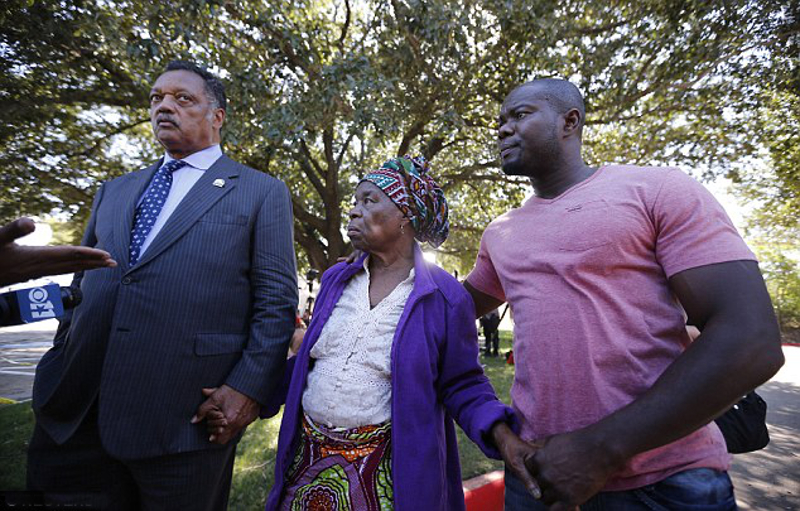 Anger at the hospital: Nowai Korkoyah, the mother of Thomas Eric Duncan, the first patient diagnosed with Ebola on U.S. soil, pictured with Reverend Jesse Jackson (left) in Dallas, Texas just before her son died.