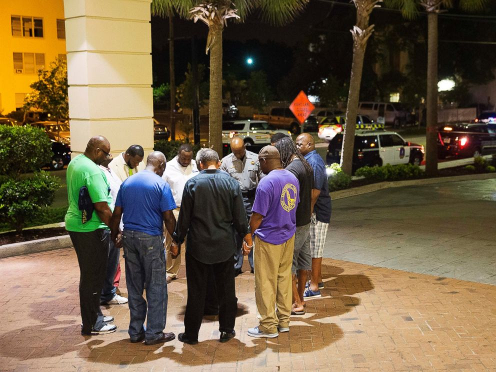 Members of the African Methodist Episcopal Church gather to pray and mourn for those who died in the carnage.