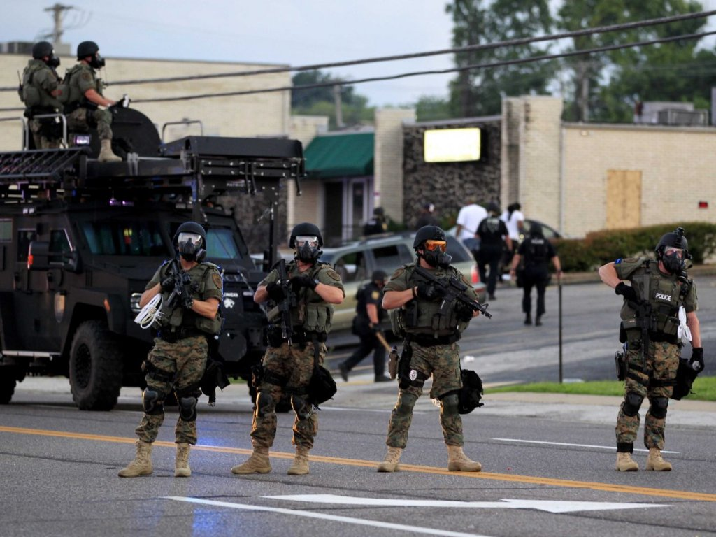 Police Reaction to Peaceful Protests in Ferguson, MO. after white Police Officer shots and kills Black boy, 12 times.