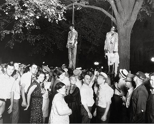 Historical Archive: Black men lynched by  white terrorists with many whites people in attendance.