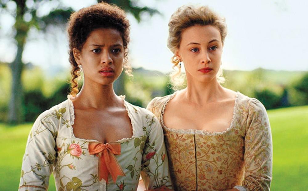 Belle (Gugu Mbatha-Raw) stands alongside her sister, Elizabeth (Sarah Gadon).